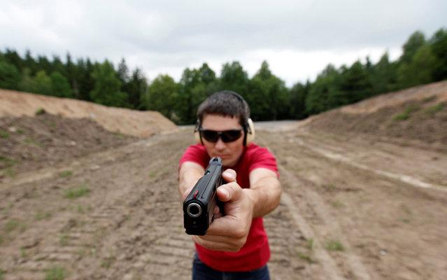 Jan Vurbs shoots his pistol at a forest shooting range near the village of Visnova, Czech Republic, June 9, 2016. (Photo by David W. Cerny/Reuters)