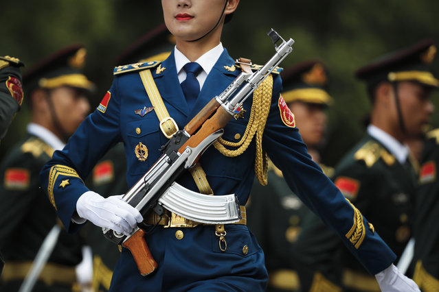 A Chinese People's Liberation Army soldier marches with members of an honor guard as they prepare for a welcome ceremony for visiting Luxembourg's Prime Minister Xavier Bettel outside the Great Hall of the People in Beijing, Monday, June 12, 2017. (Photo by Andy Wong/AP Photo)