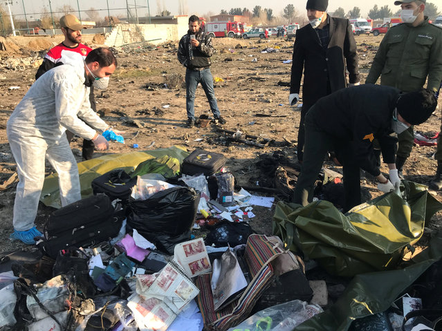 Passengers' belongings are seen after the Ukraine International Airlines plane crashed after take-off from Iran's Imam Khomeini airport, on the outskirts of Tehran, Iran on January 8, 2020. (Photo by Nazanin Tabatabaee/WANA (West Asia News Agency) via Reuters)