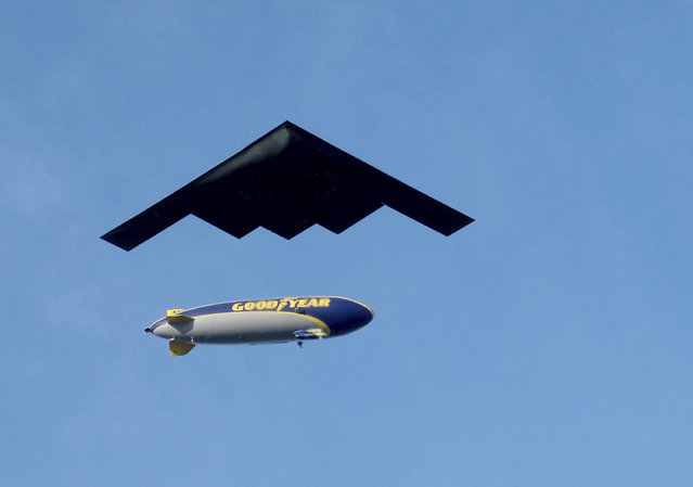 The B-2 Spirit military aircraft passes under the Goodyear airship above Colorado Boulevard during the Rose Parade in Pasadena, Calif., Wednesday, January 1, 2020. (Photo by Dean Musgrove/The Orange County Register via AP Photo)