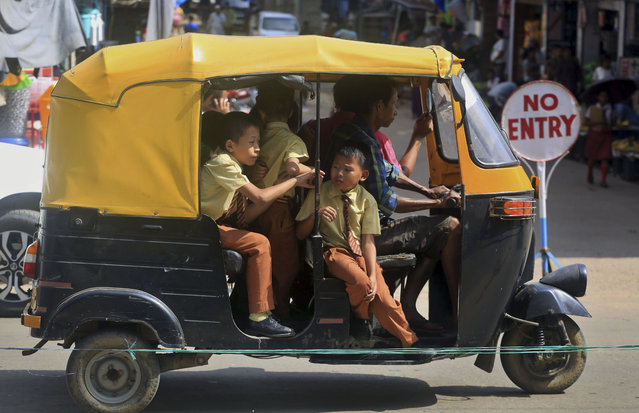 Indian school children are ferried in an auto rickshaw in Dimapur, in India's north-eastern state of Nagaland, Tuesday, August 4, 2015. (Photo by Sorei Mahong/AP Photo)