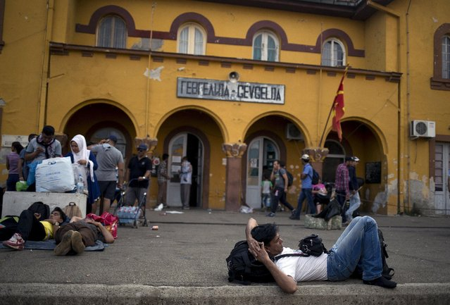 A migrant rests as he waits for a train to arrive at Gevgelija train station in Macedonia, close to the border with Greece, August 14, 2015. (Photo by Stoyan Nenov/Reuters)