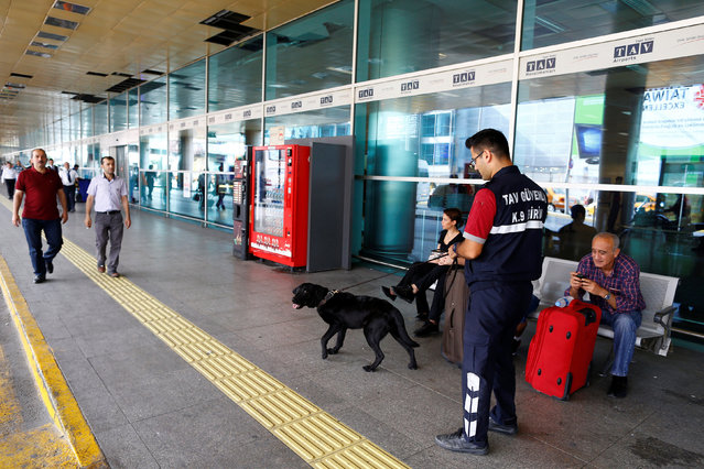A K9 unit guards one of the entrance of Turkey's largest airport, Istanbul Ataturk, following yesterday's blast June 29, 2016. (Photo by Osman Orsal/Reuters)