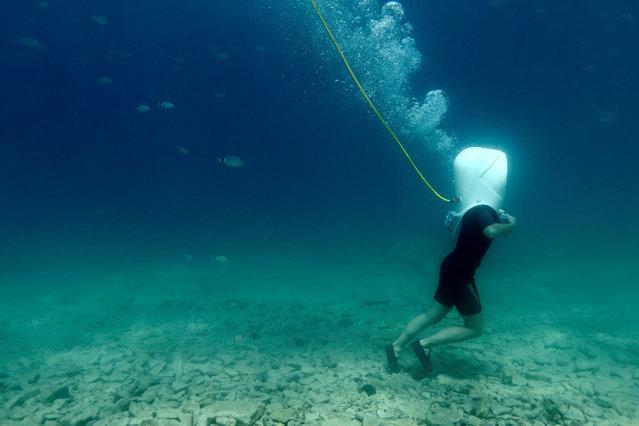 A diver walks in Underwater Park in Pula, Croatia, August 1, 2017. (Photo by Antonio Bronic/Reuters)