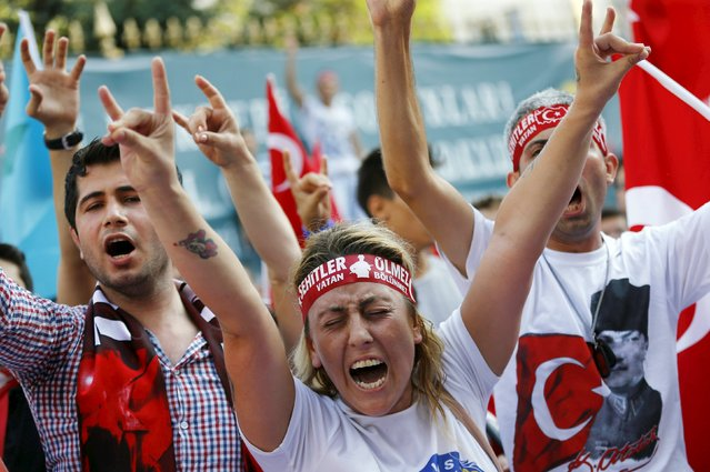 Demonstrators shout nationalist slogans during a protest against Kurdistan Workers' Party (PKK) in central Istanbul, Turkey, August 16, 2015. (Photo by Murad Sezer/Reuters)