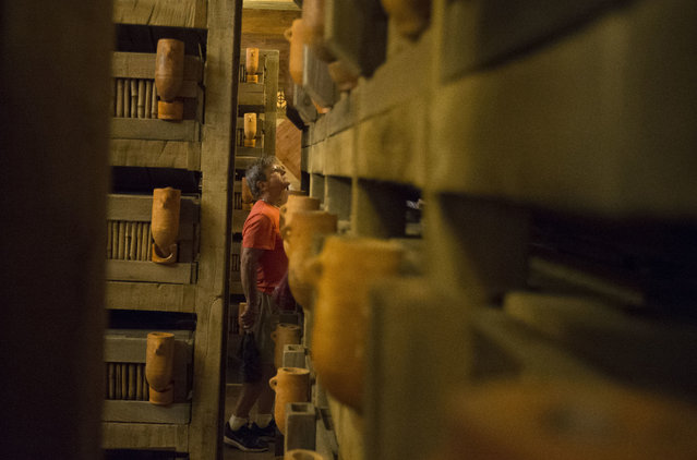 A visitor browses animal crates inside a replica of Noah's Ark at the Ark Encounter theme park during a media preview day, Tuesday, July 5, 2016, in Williamstown, Ky. (Photo by John Minchillo/AP Photo)