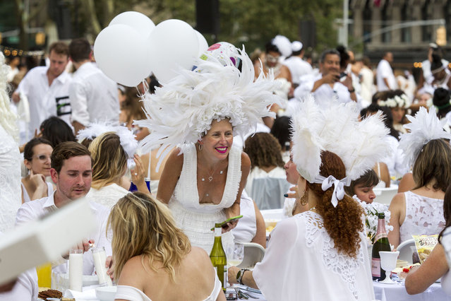 People gather and enjoy dinner at the annual Dinner en Blanc, this year hosted in Lincoln Center in New York, USA on August 22, 2017. (Photo by Erik Thomas/The New York Post)