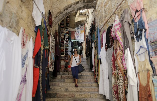 Palestinian bodybuilder Anoush Belian walks to her gym in Jerusalem's Old City August 20, 2015. (Photo by Ammar Awad/Reuters)