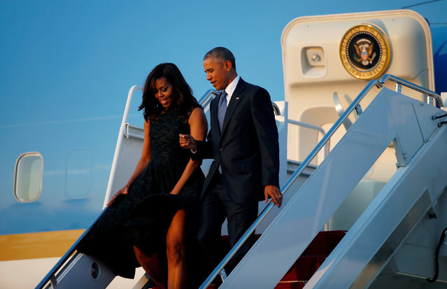 U.S. President Barack Obama and first lady Michelle Obama step from Air Force One as they return to Joint Base Andrews in Washington after attending memorial service for fallen police officers in Dallas, Texas, July 12, 2016. (Photo by Kevin Lamarque/Reuters)