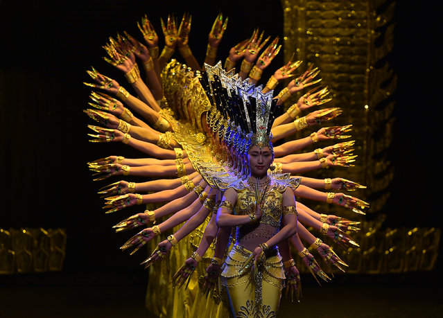 "Members of the China Disabled Peoples Performing Art Troupe perform ""My Dream"" at Jorge Eliecer Gaitan Theater in Bogota on August 30, 2017. China Disabled People's Performing Art Troupe Company composed of artists with some hearing, mental, motor, visual or speech disabilities, was founded in 1987 and is currently Honorary and Goodwill Ambassadors of Unesco for its great example of inclusion. (Photo by John Vizcaino/AFP Photo)"