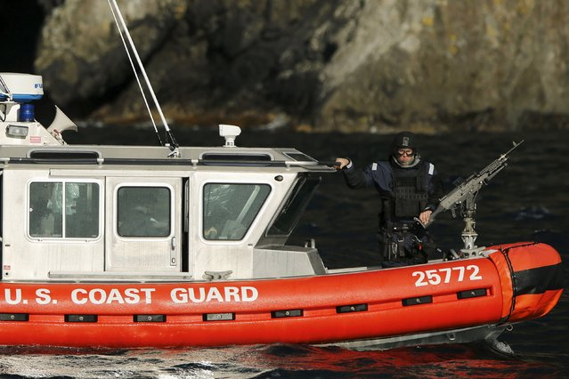 A U.S. Coast Guard vessel patrols nearby as U.S. President Barack Obama takes a boat tour of Kenai Fjords National Park in Seward, Alaska September 1, 2015. (Photo by Jonathan Ernst/Reuters)