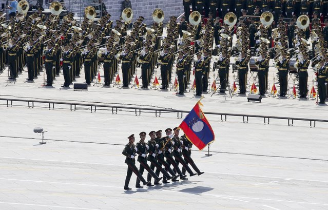 Laotian soldiers march during a military parade to mark the 70th anniversary of the end of World War Two, in Beijing, China, September 3, 2015. (Photo by Reuters/China Daily)