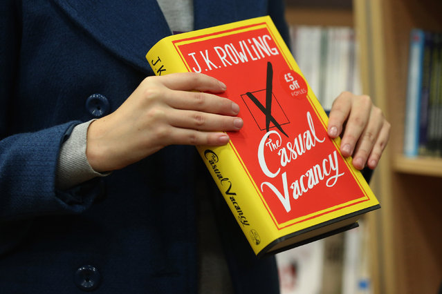A woman at Foyles bookshop holds a copy of J. K. Rowling's latest novel 'The Casual Vacancy' which has gone on sale today starting at 8:00 am on September 27, 2012 in London, England.  'The Casual Vacancy' is J. K. Rowling's first book aimed at an adult readership and is centered on a parish council election in a small West Country town.  (Photo by Oli Scarff)