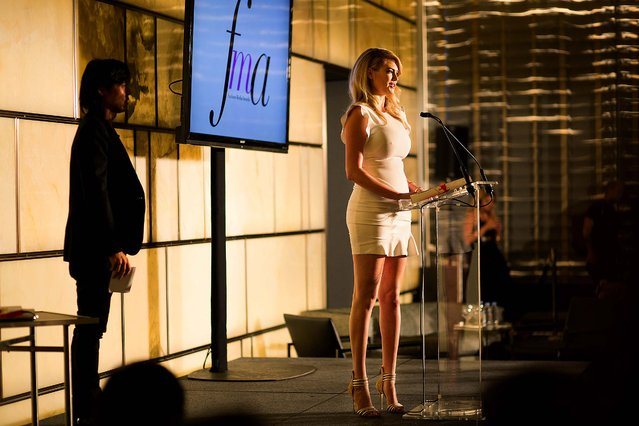 Kate Upton accepts an award at the Daily Front Row's fashion media awards show, during New York Fashion Week, September 5, 2014. (Photo by Julie Glassberg/The New York Times)