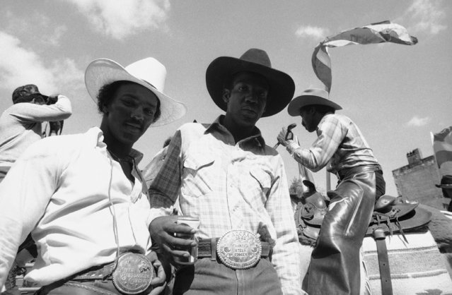 Members of the Black Cowboy Association parade past spectators during the opening ceremonies Saturday of a two-day rodeo in New York's Harlem Saturday, September 9, 1984 benefiting the United Negro College Fund and other charities. The rodeo was held a vacant lot at 137th St. and Eighth Avenue specially prepared to accommodate 15 bulls, 25 horses, 15 steers and 15 calves making up the five rodeo events from bull riding to calf roping. (Photo by Todd James/AP Photo)