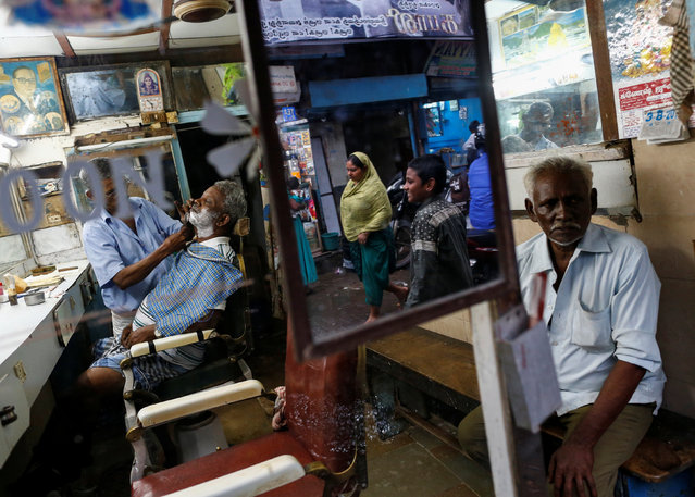 A man gets a shave inside a barber shop at a slum in Mumbai, India, August 3, 2016. (Photo by Danish Siddiqui/Reuters)