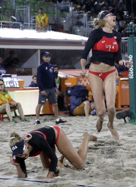 United States' April Ross, bottom, and Kerri Walsh Jennings celebrate after beating Switzerland during a women's beach volleyball match at the 2016 Summer Olympics in Rio de Janeiro, Brazil, Wednesday, August 10, 2016. (Photo by Marcio Jose Sanchez/AP Photo)