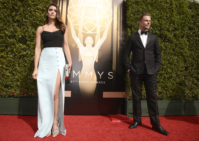 Nina Dobrev, left, and Derek Hough arrive at the Television Academy's Creative Arts Emmy Awards at Microsoft Theater on Saturday, September 12, 2015, in Los Angeles. (Photo by Dan Steinberg/Invision for the Television Academy/AP Images)