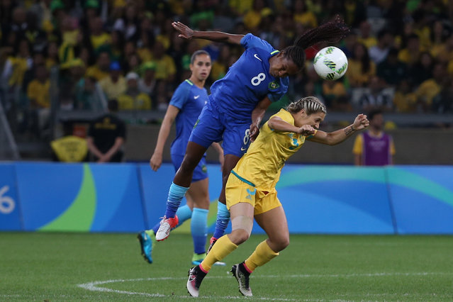 Brazil's Formiga, left, jumps for a header over Australia's Katrina Gorry during a quarter-final match of the women's Olympic football tournament between Brazil and Australia at the Mineirao Stadium in Belo Horizonte, Brazil, Friday August 12, 2016. (Photo by Eugenio Savio/AP Photo)