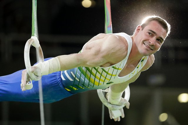 Brazil's Arthur Zanetti performs on the rings during the men's gymnastics exhibition. August 17, 2016. (Photo by Dmitri Lovetsky/AP Photo)