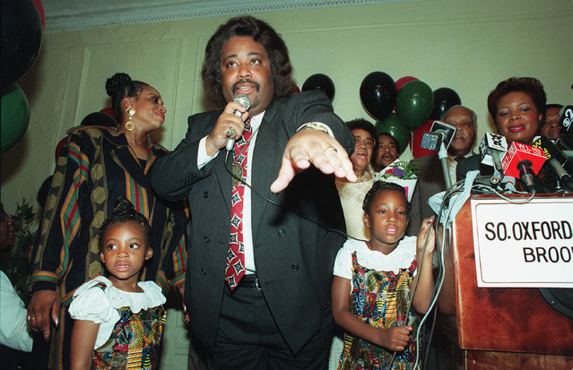 The Rev. Al Sharpton reaches out to supporters after finishing a surprising third in the U.S. Senate primary in New York City, Tuesday night on September 16, 1992.  He is flanked by his daughters Ashley, 5, left, and Domenique, 6, right. (Photo by Andrew Savulich/AP Photo)