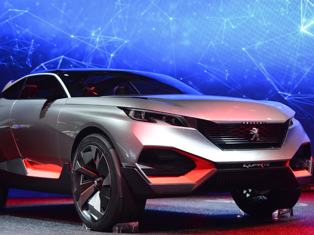 The new Peugeot Concept car Quartz is presented at the 2014 Paris Auto Show on October 2, 2014 in Paris on the first of the two press days. (Photo by Miguel Medina/AFP Photo)