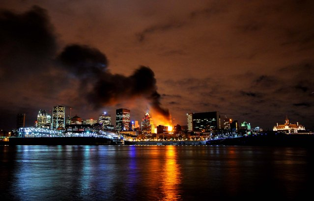 A building burns in Old Montreal, November 8, 2012. (Photo by Evan Kitaljevich/The Canadian Press)