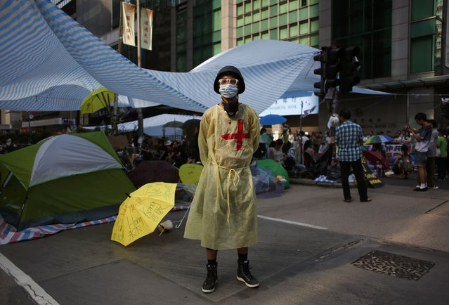 "Francis Ng, 19, a lifeguard sub-contractor poses in Mongkok shopping district in Hong Kong October 7, 2014. ""We have a team of 30 to 40 volunteers ready for the rescue. During my shift in the past eight days I have treated seven"".(Photo by Bobby Yip/Reuters)"