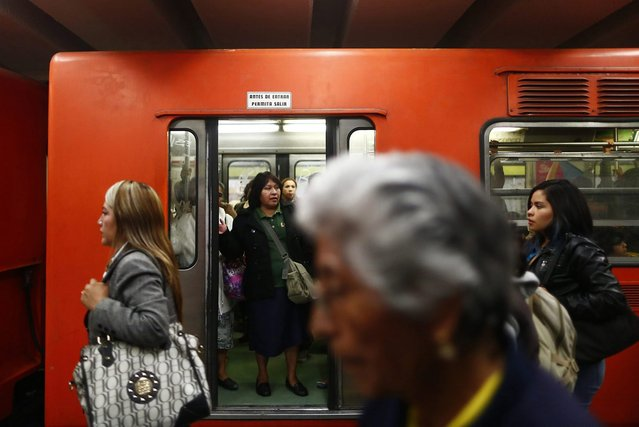 Women ride the Women-Only passenger car at a subway station in Mexico City October 23, 2014. (Photo by Edgard Garrido/Reuters)