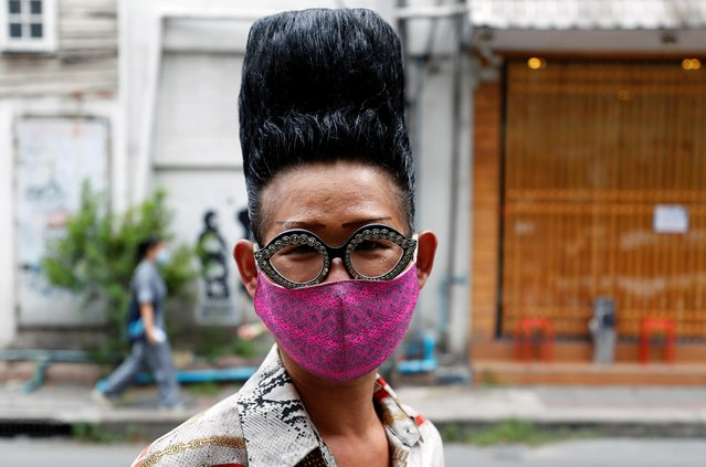 A man wears a protective face mask on a street, amid the spread of the coronavirus disease (COVID-19), in Bangkok, Thailand, August 21, 2020. (Photo by Jorge Silva/Reuters)