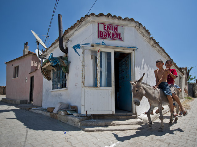 """Emin Bakkal (Emin Grocery)"". Emin Bakkal (Emin Grocery) located in Mutlu Köy (Happy Village) near Ayvalık is a small place where kids coming on their donkeys to buy chocolate. Photo location: Balikesir Ayvalik. (Photo and caption by Melih Sular/National Geographic Photo Contest)"