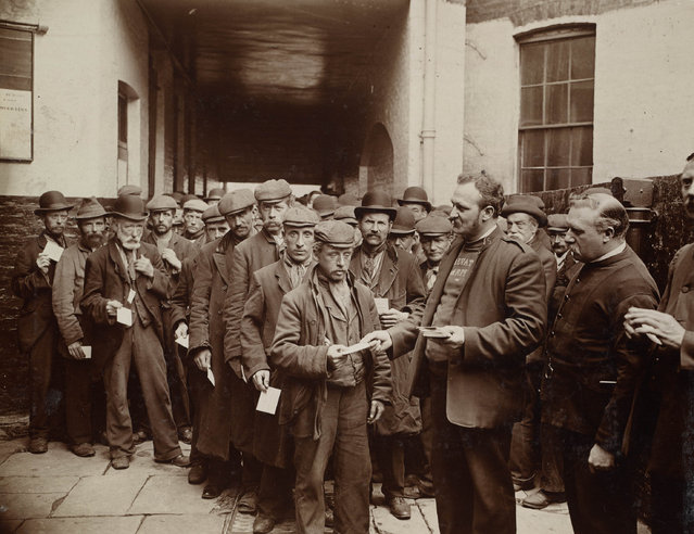 Salvation Army barracks in London during Sunday morning rush – men who had been given tickets during the night queuing for free breakfast, 1902. (Photo by Jack London/Courtesy of Contrasto)
