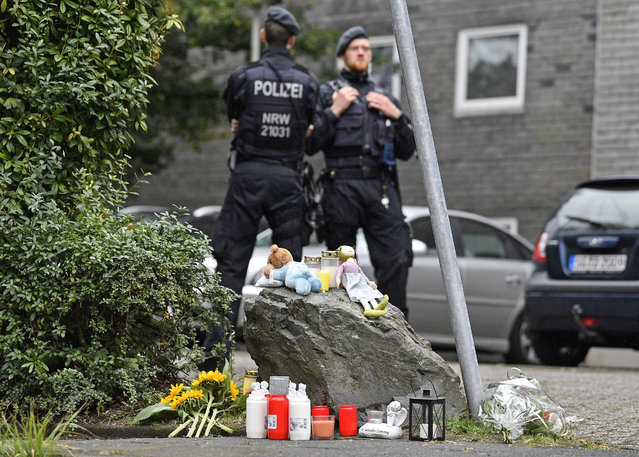 People brought flowers and candles to an apartment building, where five dead children were found in Solingen, Germany, Friday, September 4, 2020. Police say five young children have been found dead on Thursday at the apartment in Solingen, their mother is suspected of killing them. Police said the children's 27-year-old mother later jumped in front of a train in Duesseldorf and was taken to a hospital with injuries. Only one child of the mother survived, who was send to his grandmother before. (Photo by Martin Meissner/AP Photo)