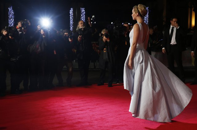 """Actress Jennifer Lawrence arrives for the world premiere of """"The Hunger Games : Mockingjay Part 1"""" at Leicester Square in London November 10, 2014. (Photo by Luke MacGregor/Reuters)"""