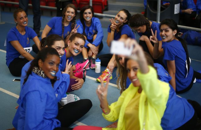 Competitors pose as Miss Egypt Amina Ashraf takes a group selfie at  the Miss World sports competition at the Lee Valley sports complex in north London, November 26, 2014. (Photo by Andrew Winning/Reuters)
