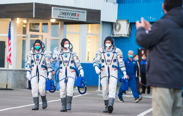 NASA astronaut Kate Rubins and Russian cosmonauts Sergey Ryzhikov and Sergey Kud-Sverchkov, members of the International Space Station (ISS) expedition 64, walk to board the Soyuz MS-17 spacecraft prior to the launch from the Russian-leased Baikonur cosmodrome in Kazakhstan on October 14, 2020. (Photo by Andrey Shelepin/Russian Space Agency Roscosmos/AFP Photo)