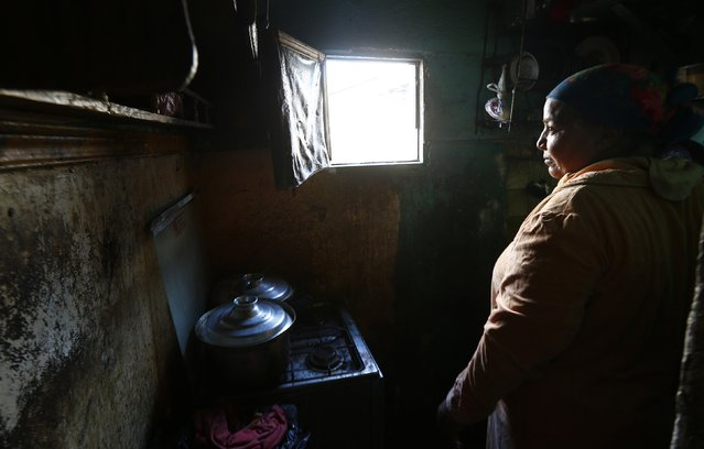 Om Mostafa, 50, cooks in her kitchen in the fishermen's village of the El Max area in the Mediterranean city of Alexandria October 18, 2014. (Photo by Amr Abdallah Dalsh/Reuters)