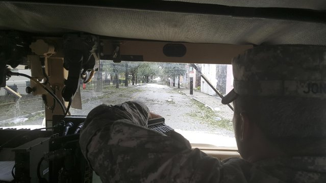 South Carolina National Guard members patrol flooded roads caused by Hurricane Matthew in Charleston, South Carolina, U.S., October 8, 2016. (Photo by Courtesy Erica Knight/Reuters/U.S. Army)