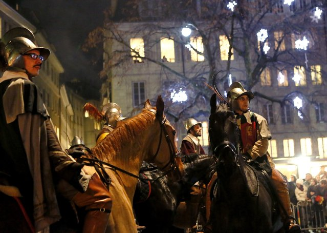 Horsemen of the Compagnie 1602 take part in a procession in Geneva December 14, 2014. (Photo by Pierre Albouy/Reuters)