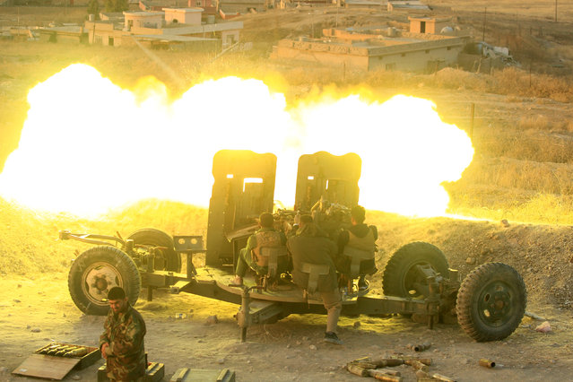 Peshmerga forces fire an anti-aircraft gun towards Islamic state militants positions in the town of Naweran near Mosul, Iraq, October 20, 2016. (Photo by Zohra Bensemra/Reuters)