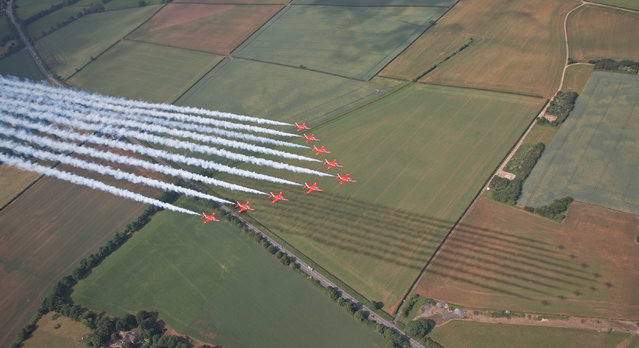 Other entries. The Red Arrows showcase their skills during a practice at RAF Scampton, Lincolnshire. This image was one of 900 submitted to this year's competition. (Photo by Cpl Adam Fletcher/2020 RAF Photo Competition)