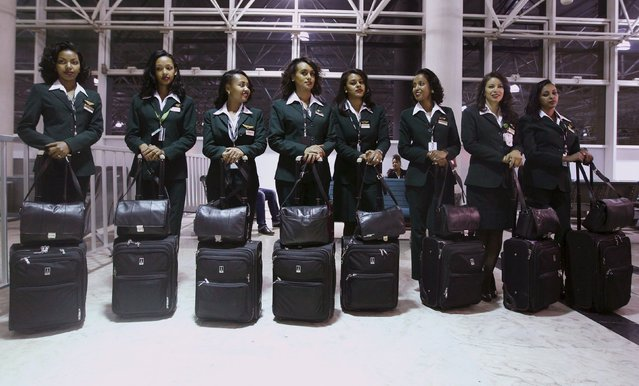 Ethiopian Airlines cabin crew members wait to get onboard the plane before takeoff at Bole international airport in the capital Addis Ababa, November 18, 2015. (Photo by Tiksa Negeri/Reuters)