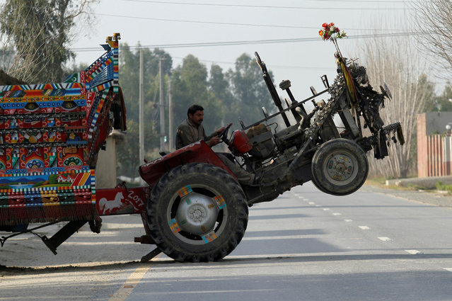 The front wheels of a tractor lift off the ground as the driver moves a heavy trailer outside Peshawar, Pakistan February 19, 2018. (Photo by Fayaz Aziz/Reuters)