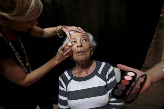 Rivka Kushnir, 85, a Holocaust survivor, has her make-up done during preparations ahead of a beauty contest for survivors of the Nazi genocide in the northern Israeli city of Haifa, November 24, 2015. (Photo by Amir Cohen/Reuters)