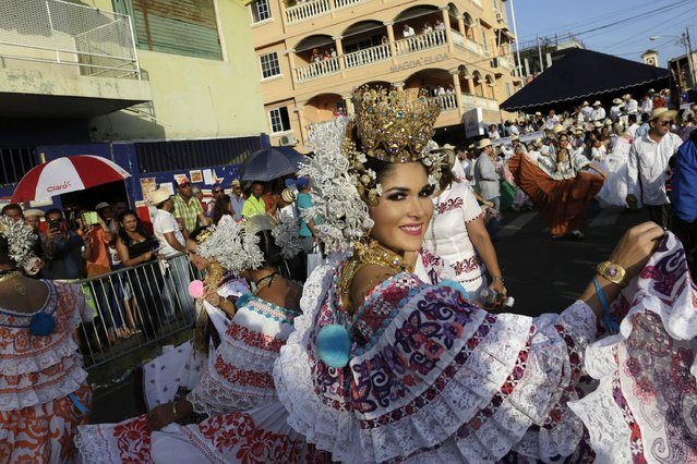"A woman wearing traditional clothing known as ""Pollera"" dances as she takes part in the annual Thousand Polleras parade in Las Tablas, in the province of Los Santos January 10, 2015. (Photo by Carlos Jasso/Reuters)"