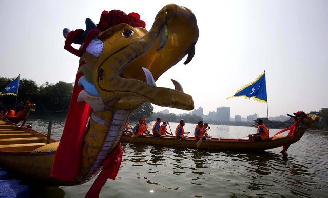 Participants get ready for a dragon boat race as part of celebrations during the Duanwu Festival, also known as the Dragon Boat Festival, in Beijing. (Photo by Ng Han Guan/Associated Press)