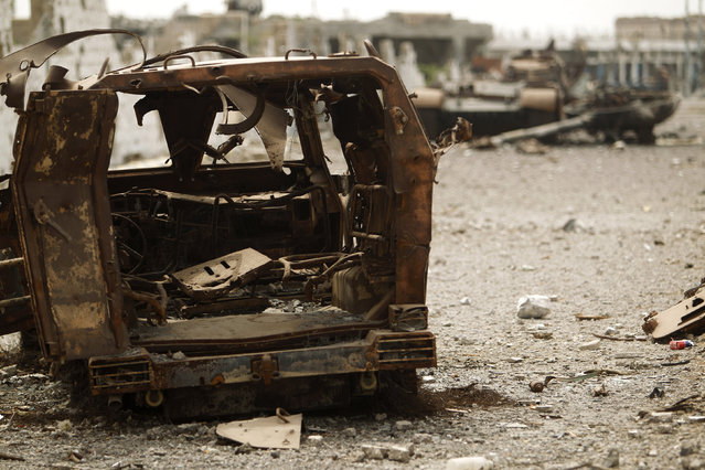 A view shows military vehicles destroyed during recent fighting between the Yemeni army and al Qaeda-linked militants in the southern Yemeni city of Zinjibar June 14, 2012. (Photo by Khaled Abdullah/Reuters)