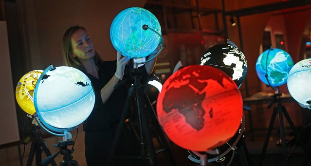 Curator Olga Subiros checks globes visualising world data at the Big Bang Data exhibition at Somerset House on December 2, 2015 in London, England. (Photo by Peter Macdiarmid/Getty Images for Somerset House)