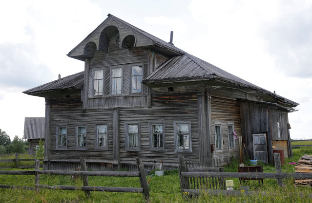 A view of a house in the village of Gridinskaya, Arkhangelsk region, Russia, July 12, 2016. (Photo by Maxim Shemetov/Reuters)
