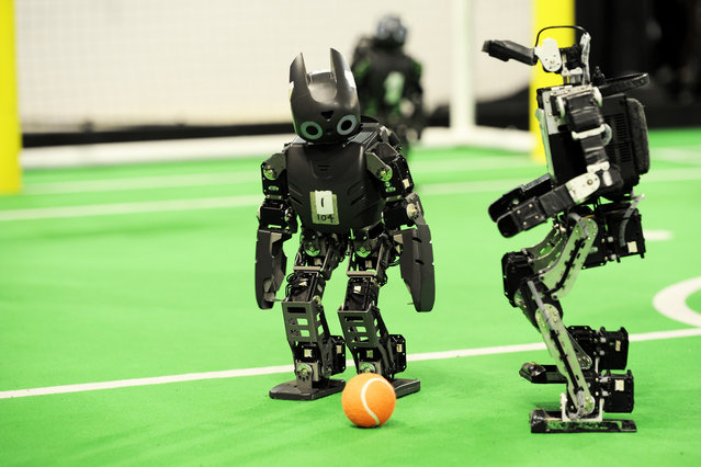 Final match Soccer Humanoid Kid Size between DARwIn vs. AUTMan at the World Championship finals of RoboCup 2013 in Eindhoven (NL). (Photo by Bart van Overbeeke)
